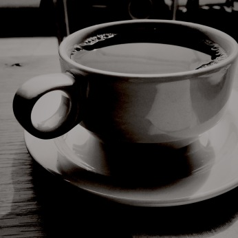 black and white photo of a coffee mug
