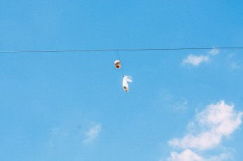 Color version of a doll's head hanging on a telephone wire